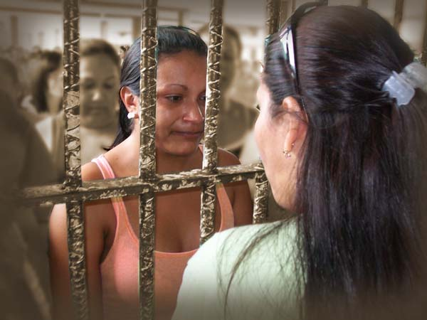 Aglow woman ministering to woman in jail